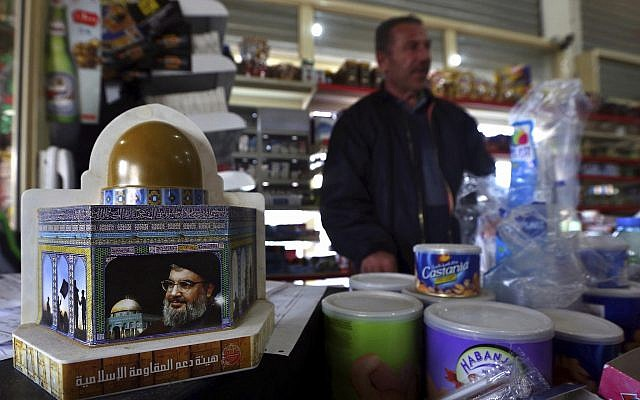A piggy bank with a photo of Hezbollah leader Sayyed Hassan Nasrallah is displayed to collect money for the group in the southern Lebanese village of Kfar Rumman, Lebanon on January 21, 2016. (AP/Bilal Hussein)