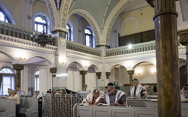 Lithuanian Jewish men pray, during a morning service in a Synagogue in Vilnius, Lithuania, Sunday, Nov. 4, 2018. (AP/Mindaugas Kulbis)