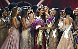 Contestants congratulate new Miss Universe Catriona Gray, center, from the Philippines during the final round of the 67th Miss Universe competition in Bangkok, Thailand on December 17, 2018.(AP/Gemunu Amarasinghe)