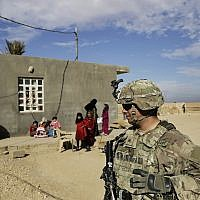 Illustrative:  In this Jan. 27, 2018, file photo, US Army soldiers speak to families in rural Anbar on a reconnaissance patrol near a coalition outpost in western Iraq. (AP Photo/Susannah George, File)