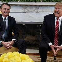US President Donald Trump speaks during a meeting with Brazilian President Jair Bolsonaro in the Oval Office of the White House, March 19, 2019, in Washington. (AP Photo/Evan Vucci)