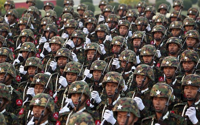 Myanmar military officers march during a parade to mark the 74th Armed Forces Day in Naypyitaw, Myanmar, March 27, 2019. (AP Photo/Aung Shine Oo)