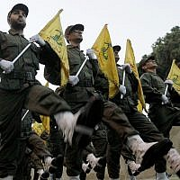 Hezbollah fighters parade during the inauguration of a new cemetery for their fighters who died fighting against Israel, in a southern suburb of Beirut, Lebanon, on November 12, 2010. (AP Photo/Hussein Malla, File)