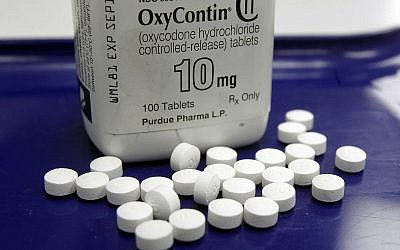 This Feb. 19, 2013, file photo shows OxyContin pills arranged for a photo at a pharmacy, in Montpelier, Vt. (AP Photo/Toby Talbot, File)