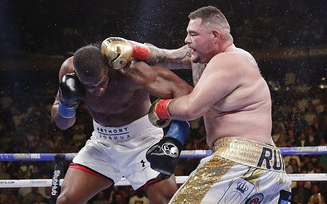 Andy Ruiz, right, punches Anthony Joshua during the seventh round of a heavyweight championship boxing match, June 1, 2019, in New York. Ruiz won the bout. (AP Photo/Frank Franklin II)