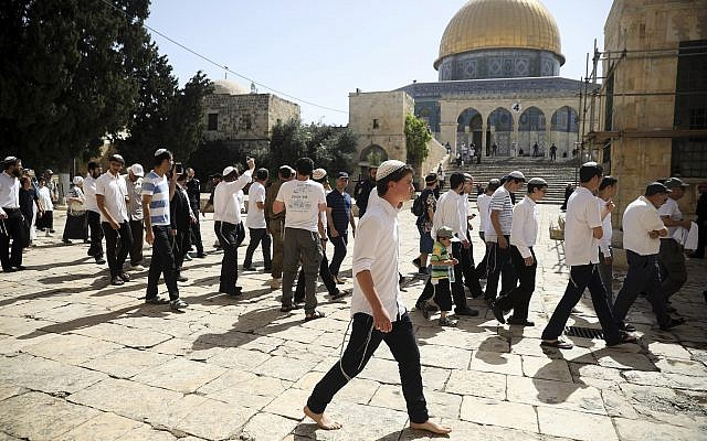 Israelis walk by the Dome of the Rock Mosque in the Temple Mount compound in Jerusalem, Sunday, June 2, 2019. (AP Photo/Mahmoud Illean)