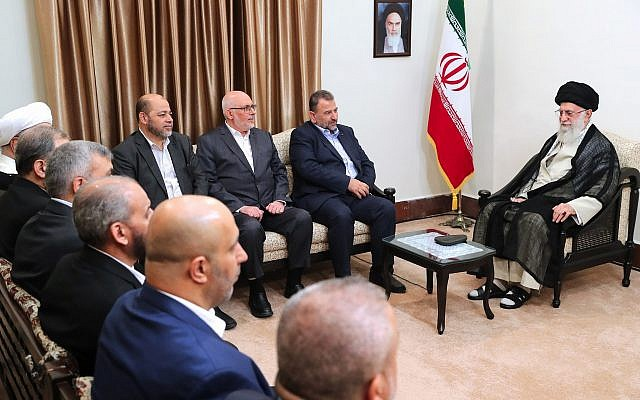 Supreme Leader Ayatollah Ali Khamenei, right, meets Hamas deputy chief, Saleh al-Arouri, second right, and a Hamas delegation, in Tehran, Iran, July 22, 2019. (Office of the Iranian Supreme Leader via AP)