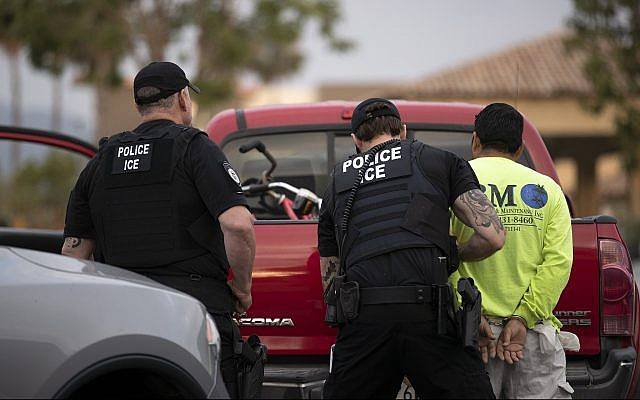 Illustrative: In this July 8, 2019, photo, US Immigration and Customs Enforcement (ICE) officers detain a man during an operation in Escondido, California. (AP Photo/Gregory Bull)