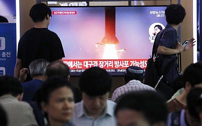People watch a TV showing a file image of North Korea's missile launch during a news program at the Seoul Railway Station in Seoul, South Korea, Wednesday, July 31, 2019. (AP/Ahn Young-joon)
