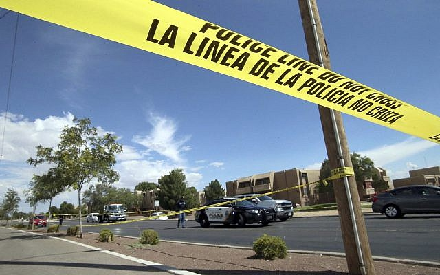 Police tape strung across an intersection behind the scene of a shooting at a shopping mall in El Paso, Texas, on Saturday, August 3, 2019 (AP Photo/Rudy Gutierrez)