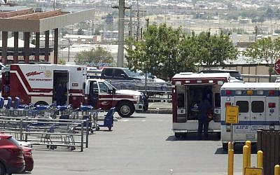 Ambulances stage in the parking near the scene of a shooting at a shopping mall in El Paso Texas on Saturday Aug. 3 2019