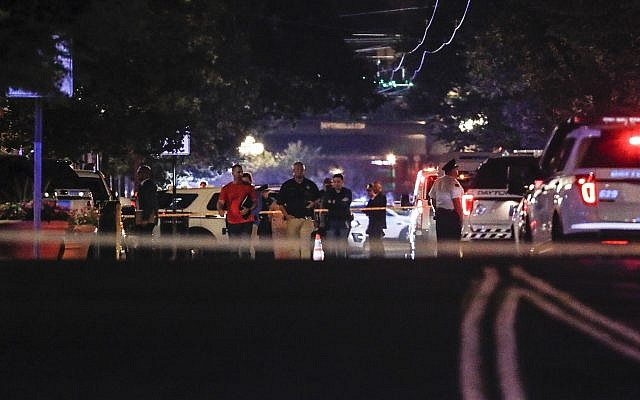 Authorities work the scene of a mass shooting, Aug. 4, 2019, in Dayton, Ohio. (AP Photo/John Minchillo)