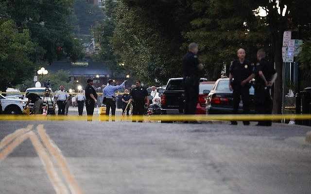Authorities work the scene of a mass shooting, August 4, 2019, in Dayton, Ohio (AP Photo/John Minchillo)