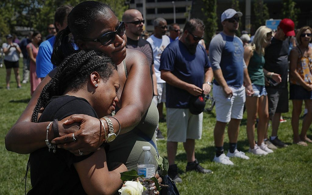 Mourners gather at a vigil following a nearby mass shooting, Aug. 4, 2019, in Dayton, Ohio (AP Photo/John Minchillo)