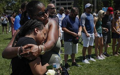 Mourners gather at a vigil following a nearby mass shooting, Aug. 4, 2019, in Dayton, Ohio (AP Photo/John Minchillo)