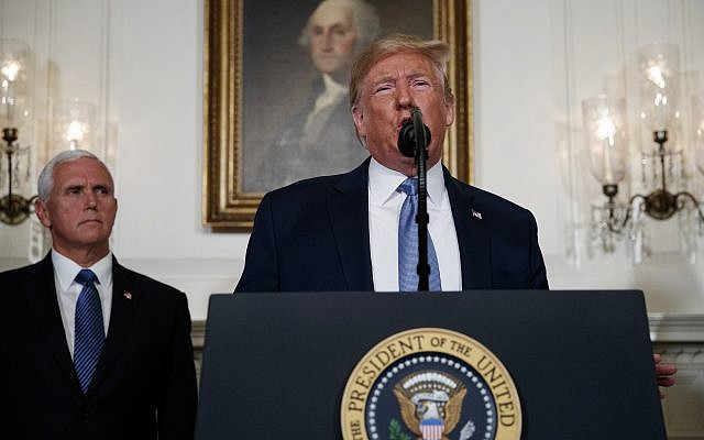 US Vice President Mike Pence, left, listens as US President Donald Trump speaks in the Diplomatic Reception Room of the White House, August 5, 2019, in Washington. (Evan Vucci/AP)