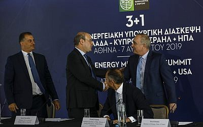 File: Greek Minister of Environment and Energy Kostas Hatzidakis, second left, shakes hands with Israel's Energy Minister Yuval Steinitz, right, as US Assistant Secretary of State for Energy Francis Fannon, second right, and Cyprus's Energy Minister Georgios Lakkotrypis , left, look on during a summit in Athens, August 7, 2019. (AP/Petros Giannakouris)