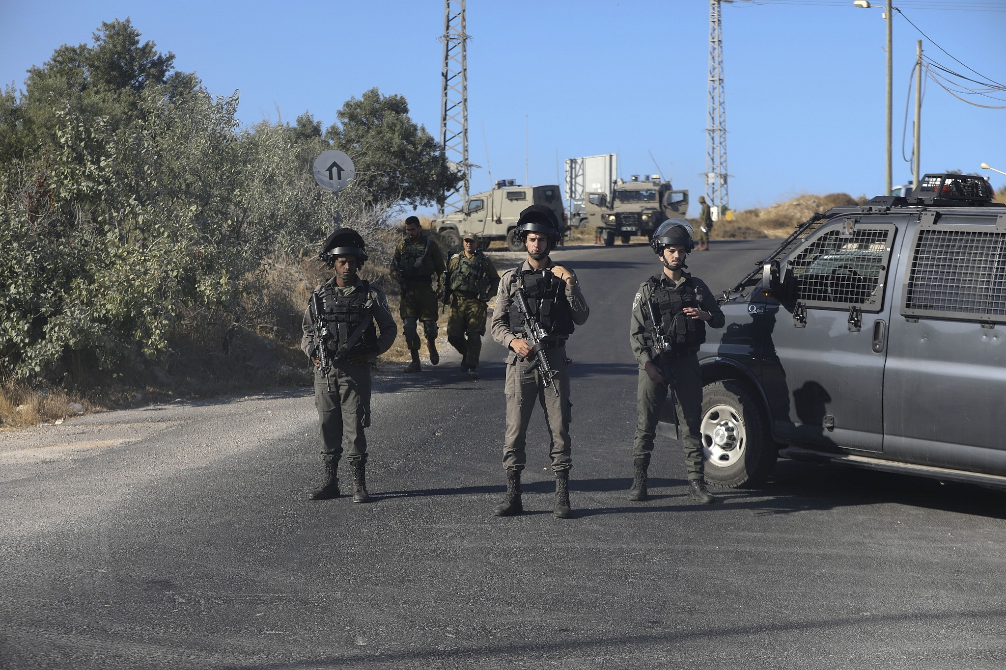Israeli troops secure the area where a body of a soldier with stab wounds was found near Gush Etzion settlement in the West Bank, Thursday, August 8, 2019. (AP/Mahmoud Illean)