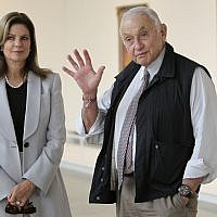 In this photo from September 19, 2014, retail mogul Leslie Wexner, right, and his wife Abigail tour the 'Transfigurations' exhibit at the Wexner Center for the Arts in Columbus, Ohio. (AP Photo/Jay LaPrete, File)