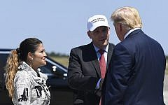 President Donald Trump, right, greets Rep. Lee Zeldin, R-N.Y., center, and his wife Diana Zeldin, left, after arriving at Francis S. Gabreski Airport in Westhampton Beach, N.Y., Friday, Aug. 9, 2019. Trump is in the Hamptons to attend a pair of fundraisers before heading to his golf club in New Jersey for vacation. (AP Photo/Susan Walsh)
