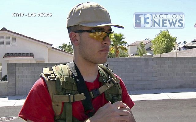 This Sept. 22, 2016, photo from video from KTNV 13 Action News shows Conor Climo during an interview while walking a Las Vegas neighborhood, heavily armed.  (KTNV 13 Action News via AP)
