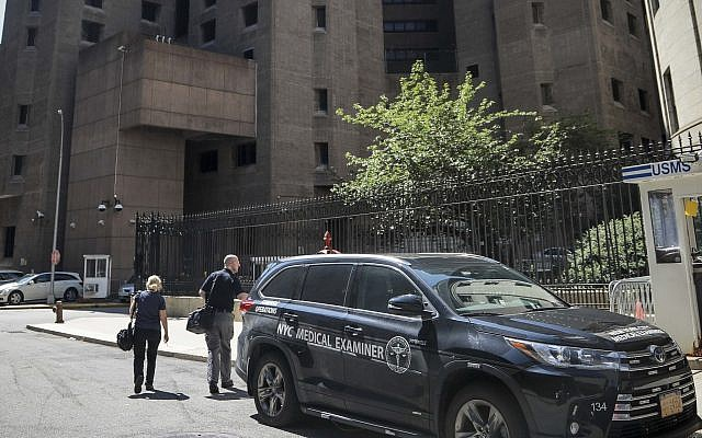 New York City medical examiner personnel leave their vehicle and walk to the Manhattan Correctional Center where financier Jeffrey Epstein died by suicide while awaiting trial on sex-trafficking charges, August 10, 2019, in New York. (AP/Bebeto Matthews)