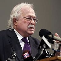 FILE - In this Aug. 18, 2014, file photo, pathologist Dr. Michael Baden speaks during a news conference to share preliminary results of a second autopsy done on Michael Brown in St. Louis County, Missouri. (AP Photo/Jeff Roberson, File)
