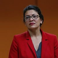 U.S. Rep. Rashida Tlaib, D-Michigan., listens to a constituent in Wixom, Mich., Thursday, Aug. 15, 2019. (AP Photo/Paul Sancya)