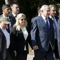 Israeli Prime Minister Benjamin Netanyahu, center right, and wife Sara, walk to visit a monument in Babi Yar ravine where Nazi troops machine-gunned many thousands of Jews during WWII, in Kyiv, Ukraine, on August 19, 2019.  (AP/Efrem Lukatsky)