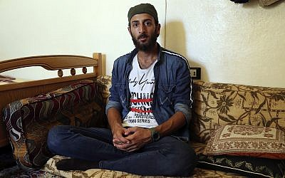 Abdullah Abdullkader, 27, from Aleppo, August 10, 2019, in Afrin, Syria. (AP Photo)