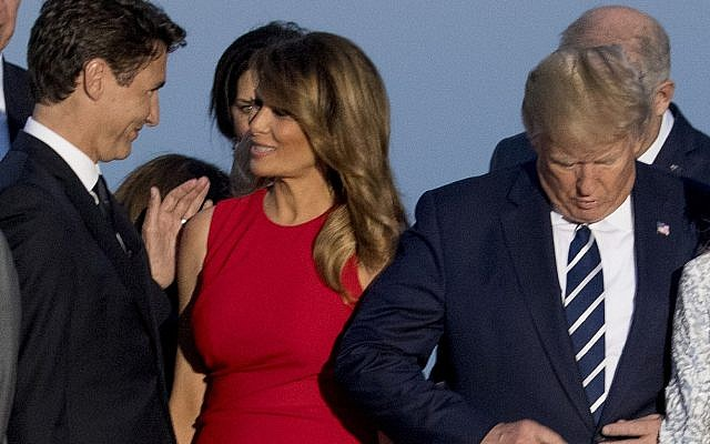 From left, Canadian Prime Minister Justin Trudeau, first lady Melania Trump, and President Donald Trump, arrive for the G-7 family photo at G-7 summit at the Hotel du Palais in Biarritz, France, Sunday, Aug. 25, 2019. (AP/Andrew Harnik)
