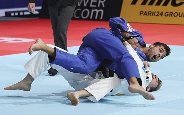 Sagi Muki of Israel, top, competes against Matthias Casse of Belgium during a men's -81 kilogram final of the World Judo Championships in Tokyo, Wednesday, Aug. 28, 2019. (AP Photo/Koji Sasahara)