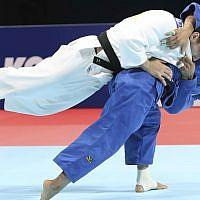 Luka Maisuradze of Georgia, top, competes against Saeid Mollaei of Iran during a men's -81 kilogram bronze medal match of the World Judo Championships in Tokyo, August 28, 2019. (AP Photo/Koji Sasahara)