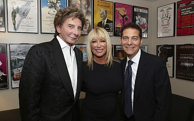 "From left: Composer Barry Manilow, Music, actress Suzanne Somers and Michael Feinstein pose backstage after the opening night performance of ""Harmony"" at Center Theatre Group/Ahmanson Theatre on Wednesday, March 12, 2014, in Los Angeles, California (Ryan Miller/Invision/AP)"