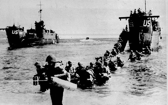 Allied troops wade through the water from a landing ship on an unidentified beach, east of Toulon, southern French riviera, as part of Operation Dragoon, in this Aug 16, 1944, photo (AP Photo)