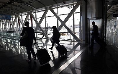 Illustrative: Travelers move through Logan International Airport in Boston January 28, 2015. (Elise Amendola/AP)