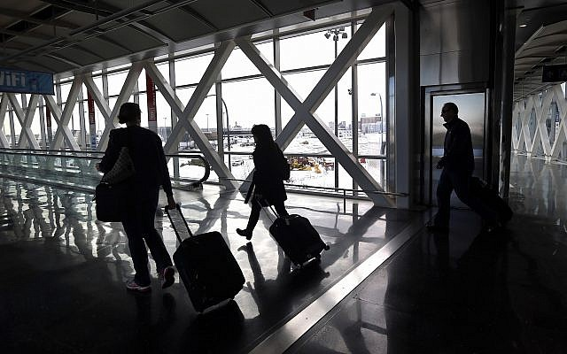 Illustrative: Travelers move through Logan International Airport in Boston January 28, 2015. (Elise Amendola/AP)