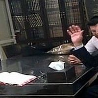 Avigdor Liberman meets with hardline Rabbi Shmuel Auerbach in Jerusalem in 2013. (Channel 12 screenshot)
