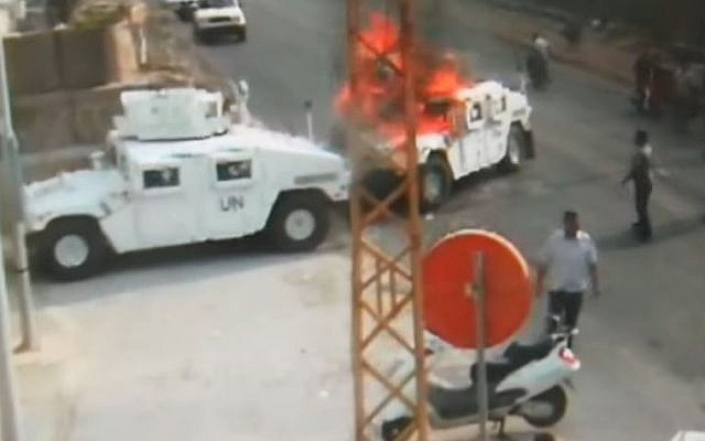 Hezbollah members set a United Nations peacekeepers' vehicle on fire in an incident in 2018 in southern Lebanon. the footage was first aired on August 28, 2019 (Screencapture/YouTube)