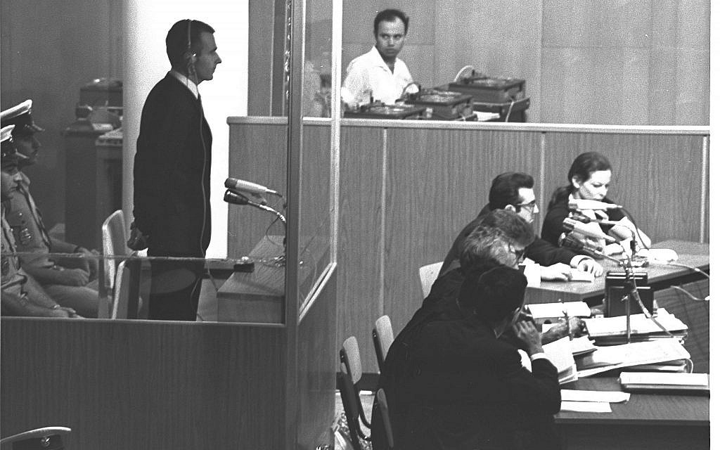 Denis Michael Rohan stands inside a bulletproof glass box at the opening session of his trial for setting fire to the al-Aqsa Mosque, at Binyanei Hauma convention center, Jerusalem, October 6, 1969. (Fritz Cohen/GPO)