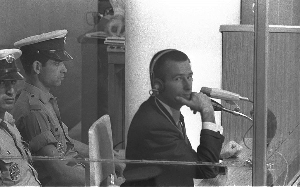 Denis Michael Rohan sits inside a bulletproof glass box at his trial for setting fire to the al-Aqsa Mosque, at Binyanei Hauma convention center, Jerusalem, October 7, 1969. (Fritz Cohen/GPO)