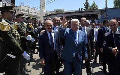 (L-R) Palestinian Authority Prime Minister Mahmoud Shtayyeh and President Mahmoud Abbas tour the Jalazone refugee camp in the West Bank on August 10, 2019. (Wafa)