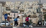 Illustrative: Ultra-Orthodox girls in the central West Bank settlement of Modiin Illit cross the street on their way to school, October 19 2009. (Nati Shohat/Flash90)
