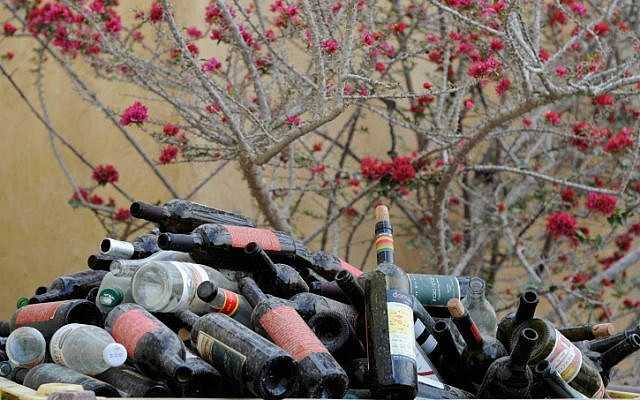 Recycled bottles pile up at the Carmey Avdat Wines, Negev on January 7, 2013. Wine and beer bottles are cleaned and reused, irregular glass is crushed and shipped to Europe to make new glass objects. (Louis Fisher/Flash90)