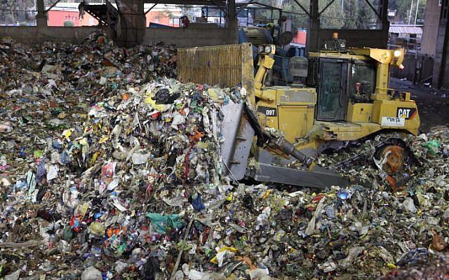 Solid waste is sorted and separated at a facility next to the Hiriya Landfilll near Tel Aviv on November 11, 2008. (Yaakov Naumi/Flash90)
