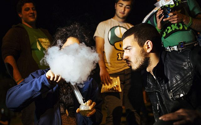Illustrative: Young Israelis protest for the legalization of marijuana outside the Knesset in Jerusalem on April 20, 2014. (Matanya Tausig/Flash90)