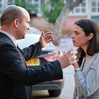 Leader of the Jewish Home party Naftali Bennett seen with MK Ayelet Shaked, prior to an event for members of his party at the Jewish Home party headquarters, where they agreed on the new government coalition deal. May 10, 2015. (FLASH90)