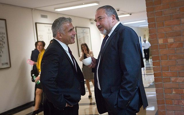 Yisrael Beytenu party leader Avigdor Liberman (R) speaks with Yesh Atid chief Yair Lapid at the Knesset on November 16, 2015. (Miriam Alster/ Flash90)