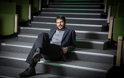 Bezalel Smotrich sitting casually in the Knesset, on April 12, 2016. (Hadas Parush/Flash90)