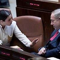 Prime Minister Benjamin Netanyahu speaks with then-justice minister Ayelet Shaked, left, during a vote on the 2017-2018 state budget in the Knesset plenum, December 21, 2016. (Yonatan Sindel/Flash90)